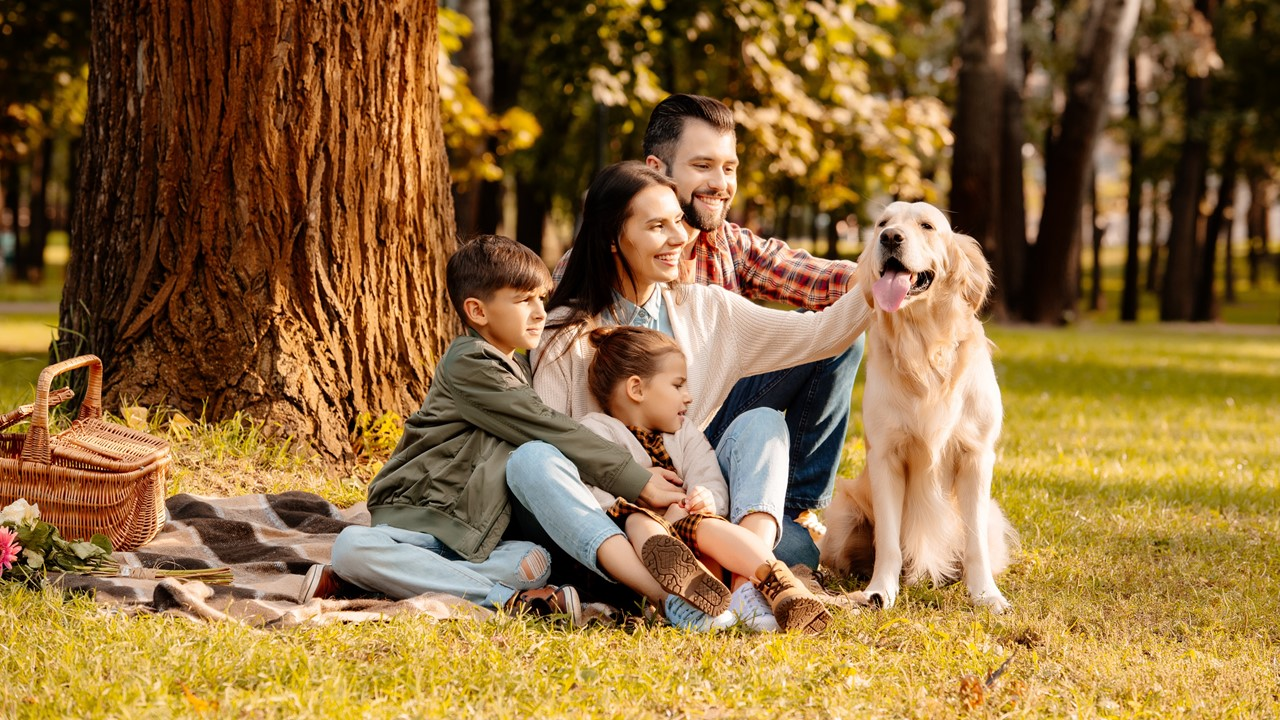 A family and their dog enjoing a fall picnic - Lafayette apartments - apartments in Lafayette La