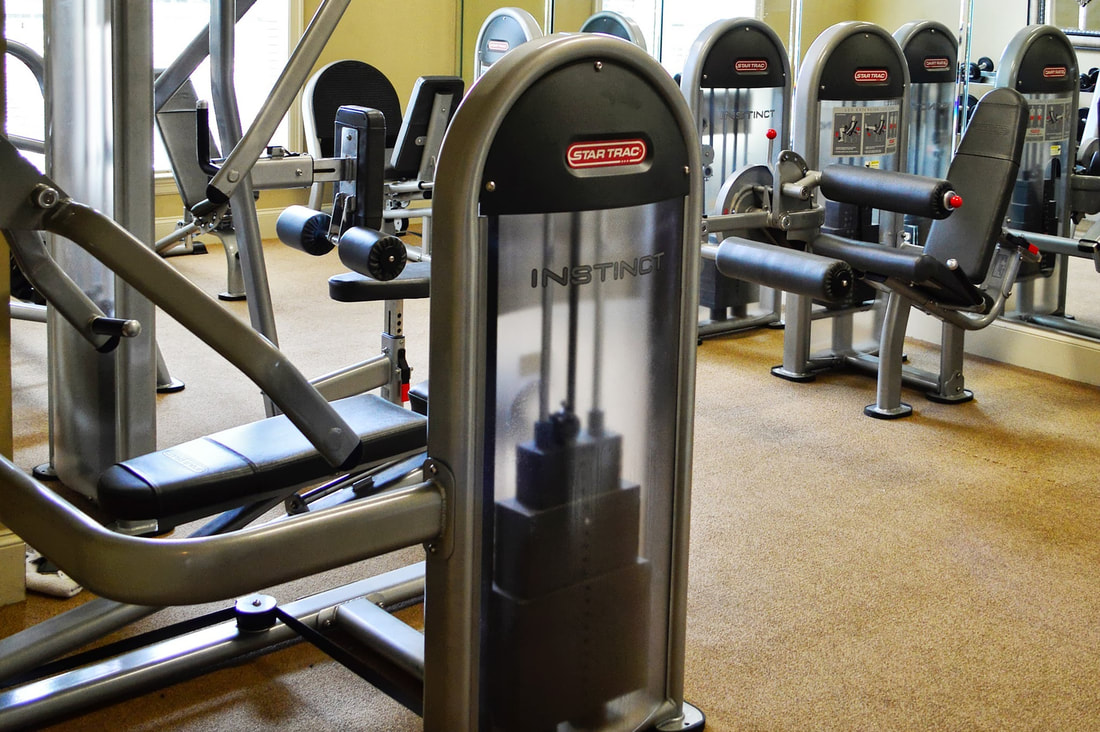 Image of a fitness center at Lafayette Gardens - apartments with a gym - lafayette la